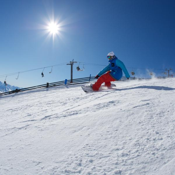 Snowboarder riding at The Remarkables ski field