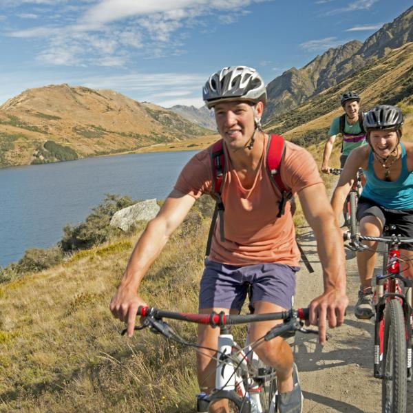 Friends biking at Moke Lake Queenstown