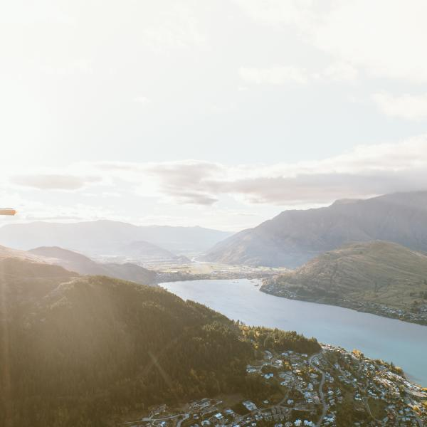 Helicopter flight over Queenstown at sunrise