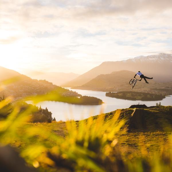 Mountain biker jumping above Queenstown, NZ