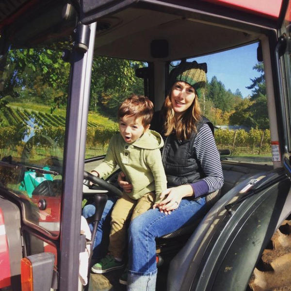 Winemaker Rachel Rose on tractor with son Shea