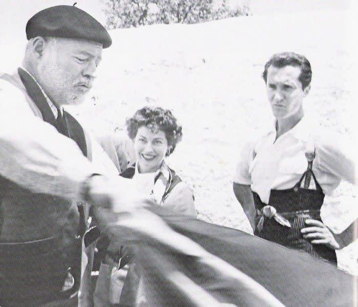 Ernest Hemingway demonstrating his bullfighting technique for Ava Gardner and Luis Dominguin