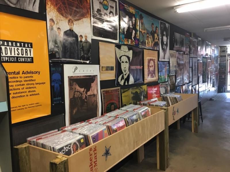 Photo of records and music posters at Growl Records