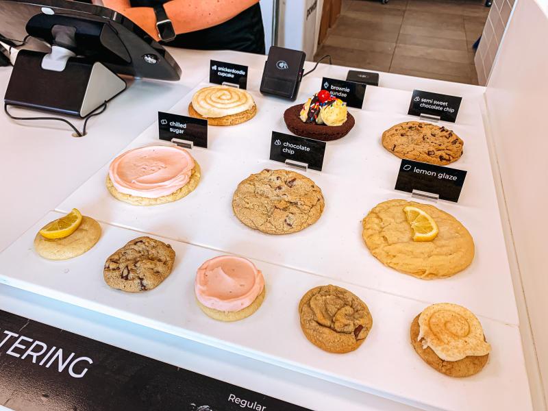 Display of Crumbl Cookies' weekly selection of cookies
