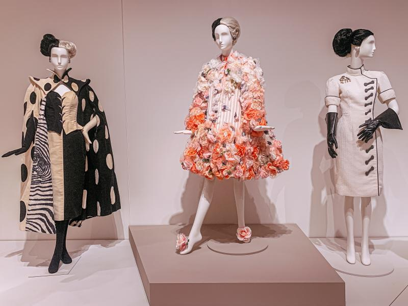 Three mannequins in Cruella De Vil costumes at the Eskenazi Museum of Art's Glenn Close exhibit