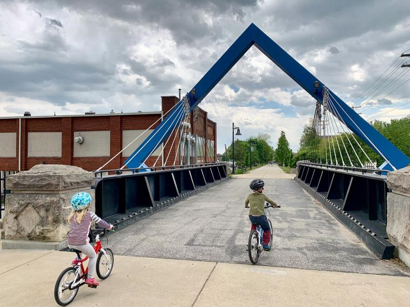 Two kids riding bikes on the B-Line Trail