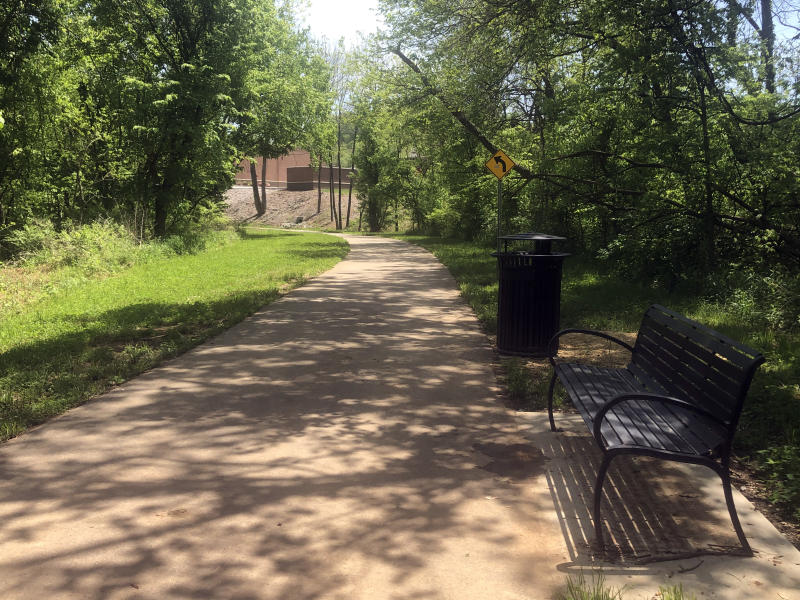 shaded paved trail near a river