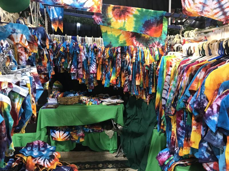 A booth full of tie dyed apparel at the Eugene Saturday market