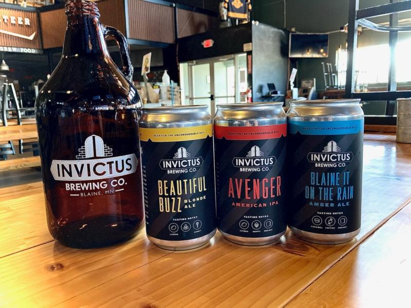 Beer growler and cans at Invictus Brewing Co.