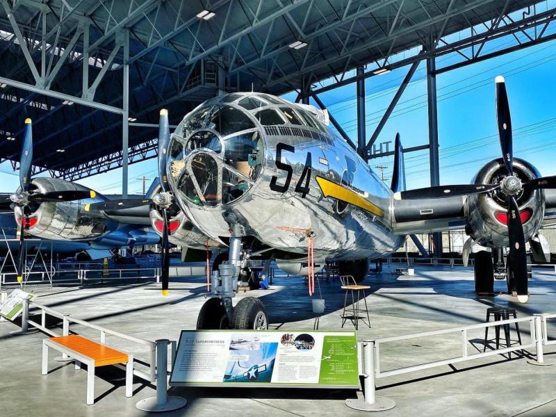 WWII Bomber in sunlit hangar