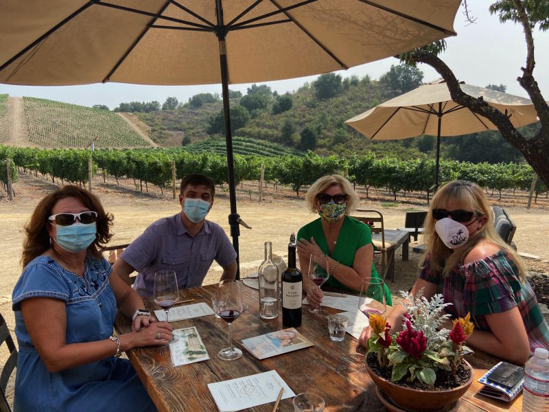 Group at winery in masks