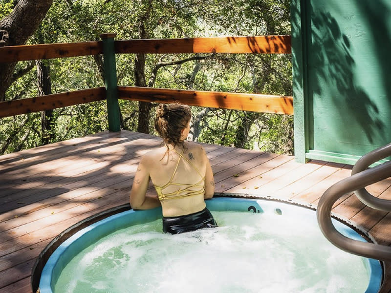 Woman Relaxing In A Sycamore Mineral Springs Hot Tub