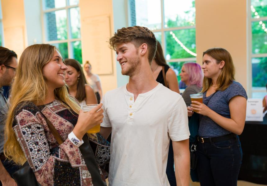 couple talking at Arts and Draughts