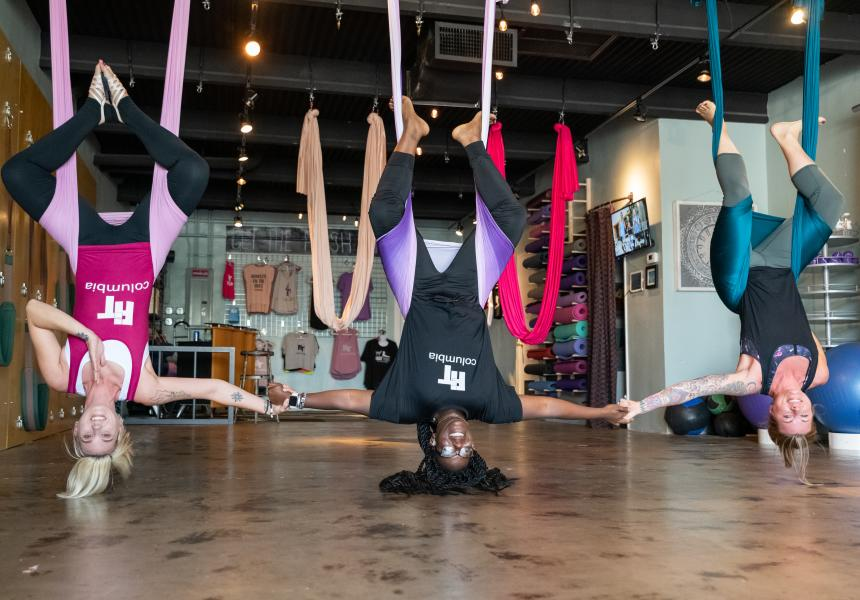 People Doing Yoga While Hanging From The Ceiling In Columbia, SC