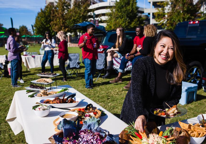 Woman at tailgate buffet
