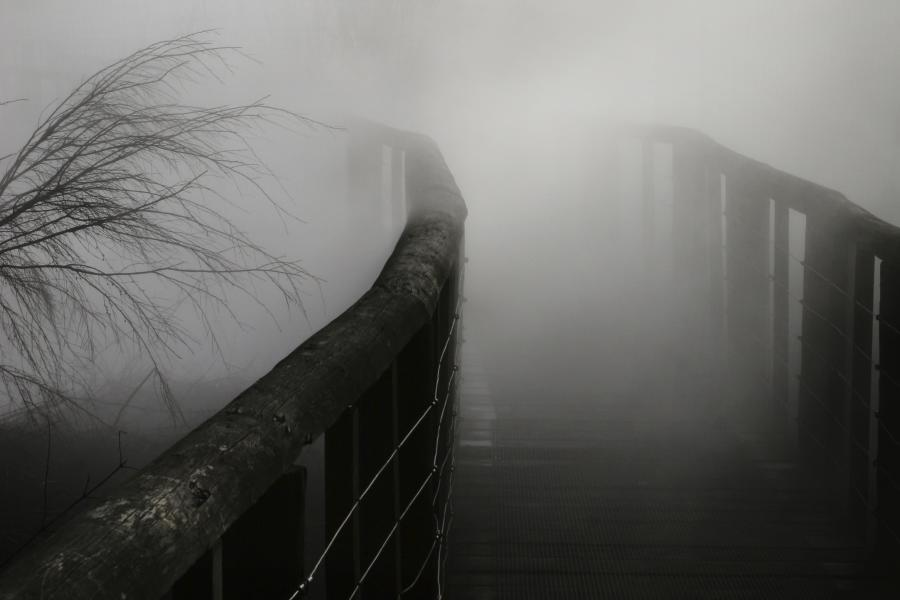 Black bridge with fog over it