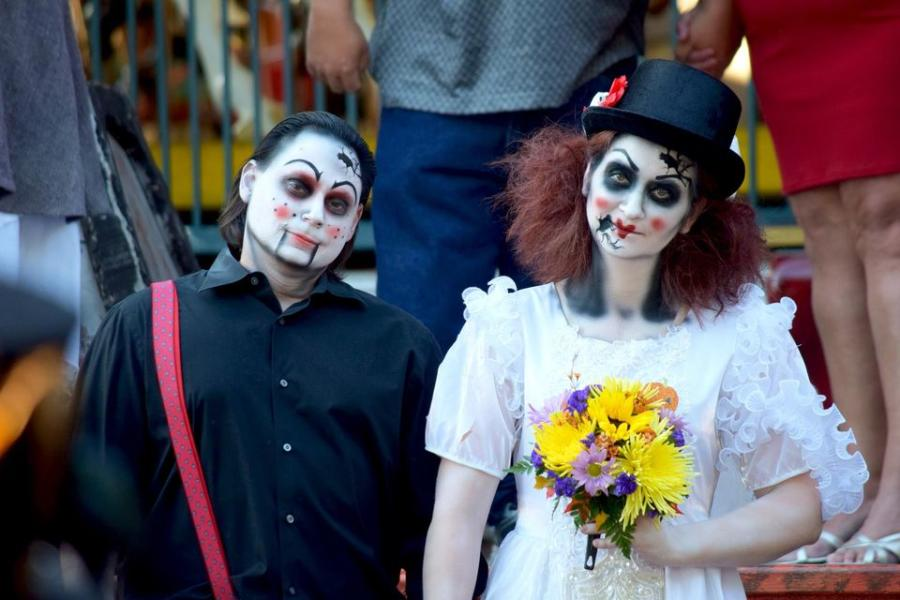 Two people in Halloween makeup for Six Flags Over Texas Frightfest