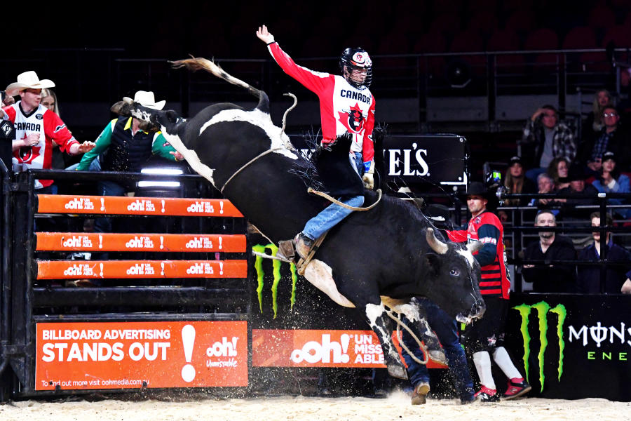 Photo of PBR team member from Canada riding bull