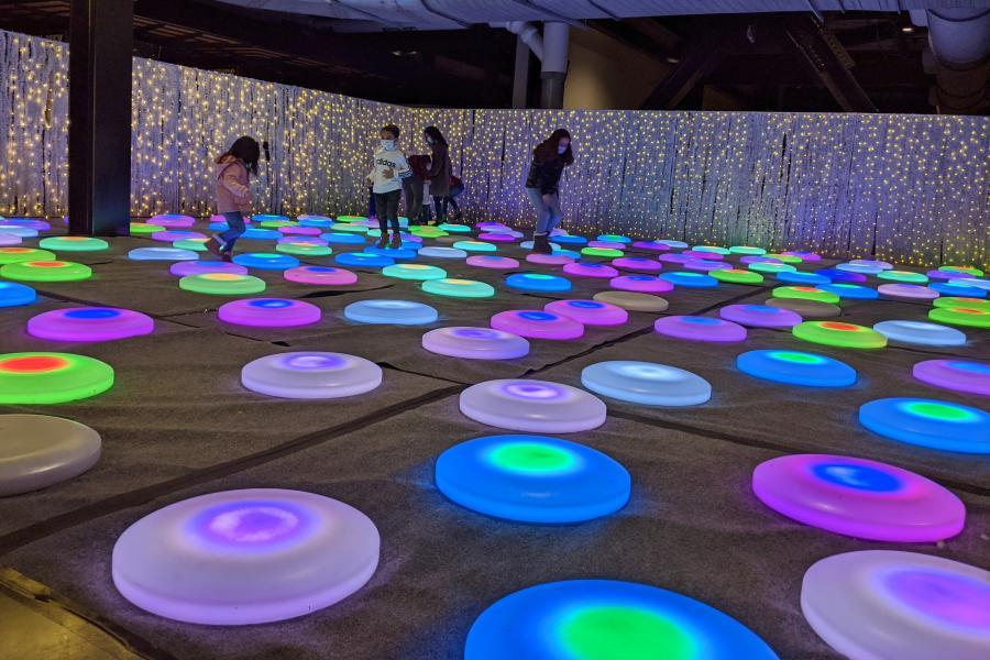 Photo of children on light up dots at Luminova