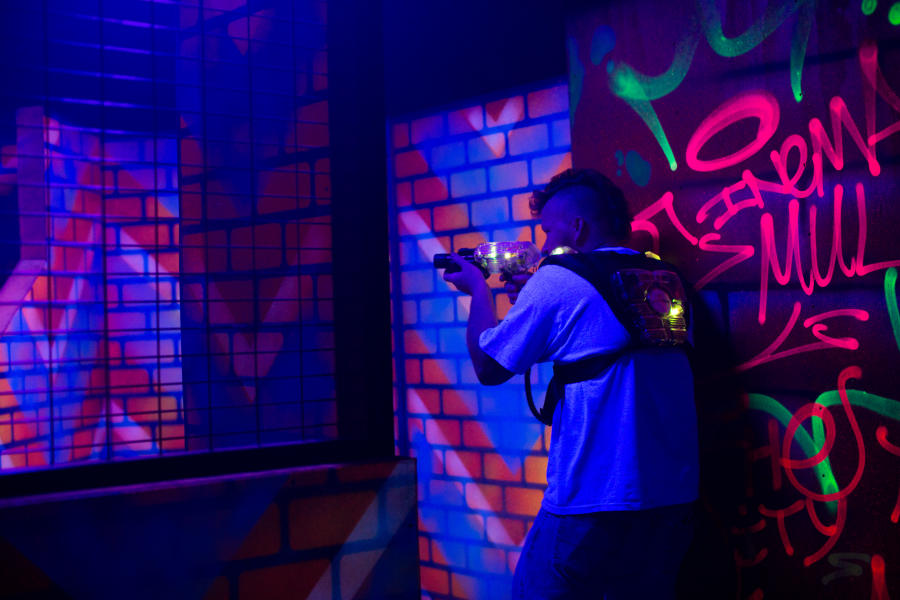 boy playing indoor laser tag