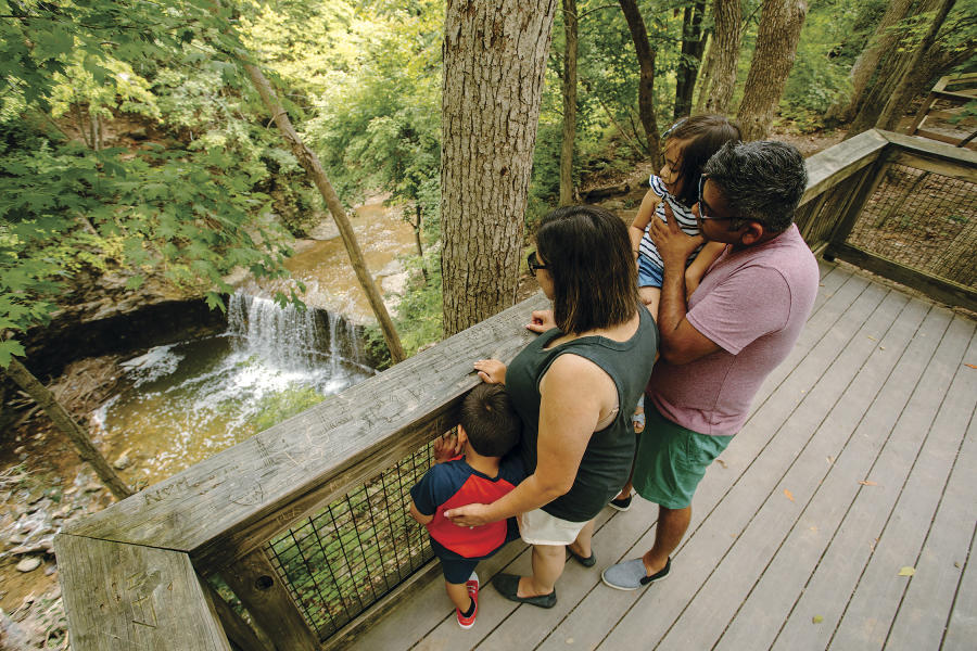 Family looking over the observation deck down to Indian Run waterfall