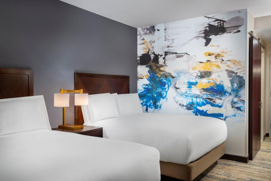 Hotel Room with colorful wall mural by Nicola Parente