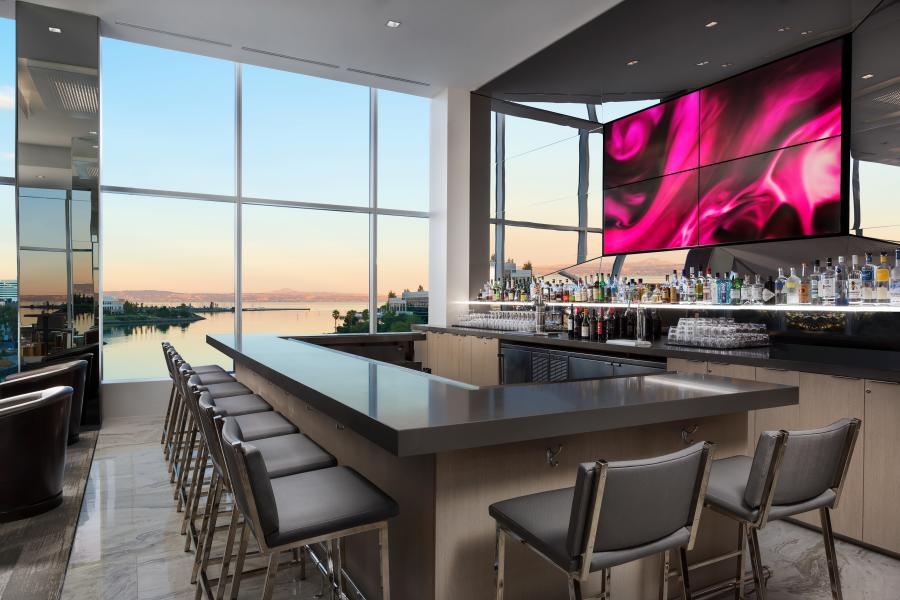 View of the bar lounge in the AC Hotel Airport Oyster Point Waterfront.