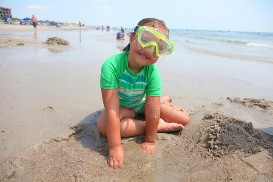 Girl with Goggles Playing on Carolina Beach