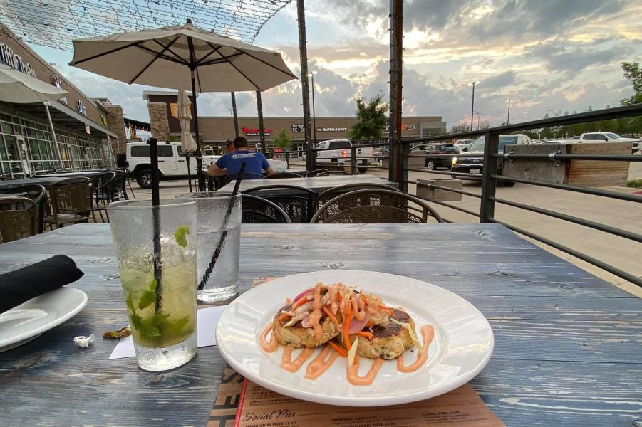 Photo of plate of food on patio at Social House