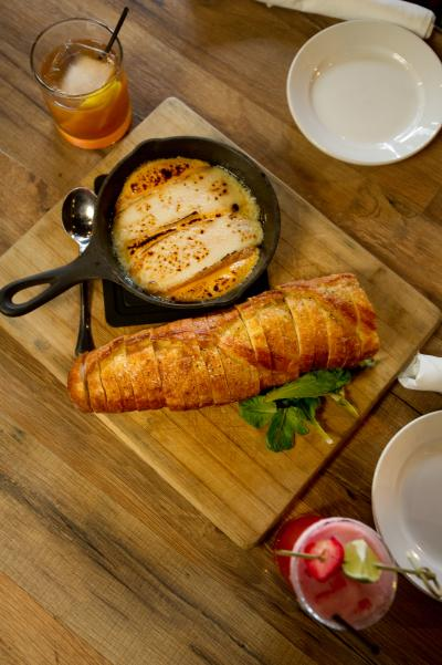 Beer Cheese served in a skillet with a baguette at the Red Yeti