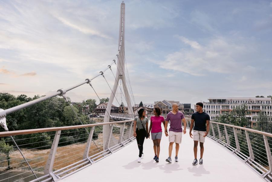 Family walking across the Dublin Link pedestrian bridge