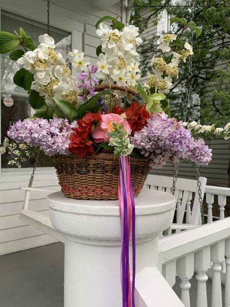 A May Day Basket on a porch post