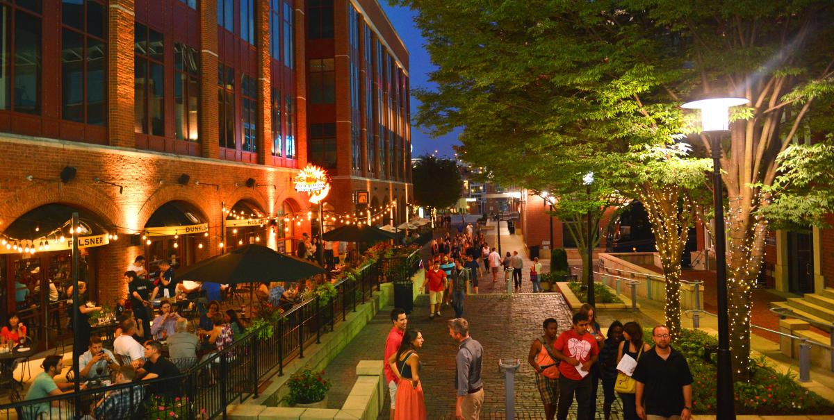 Lights dazzle at night in the Arena District of Columbus, Ohio.