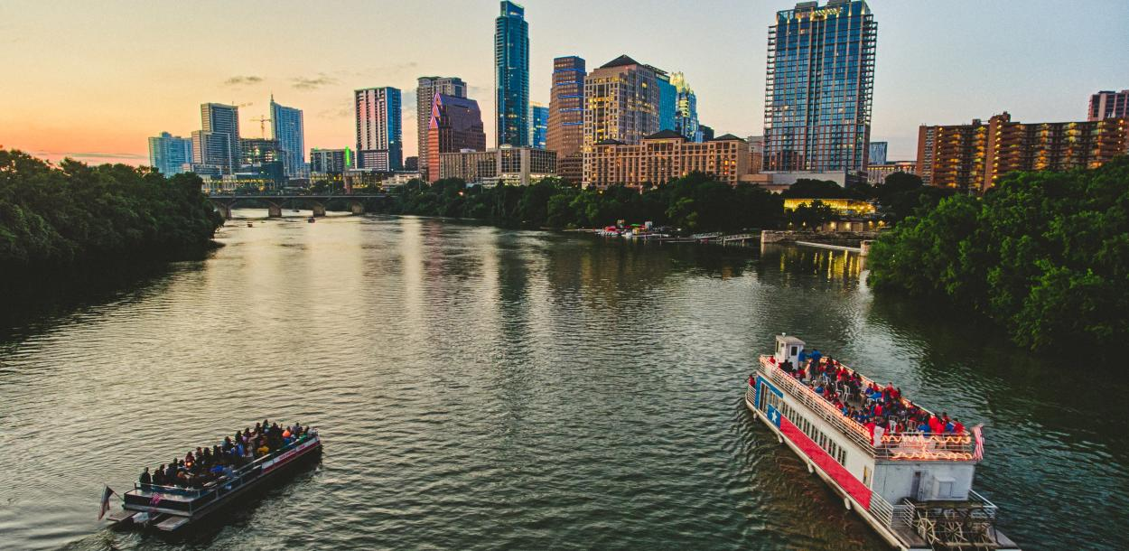 River boats on Lady Bird Lake at sunset in austin texas
