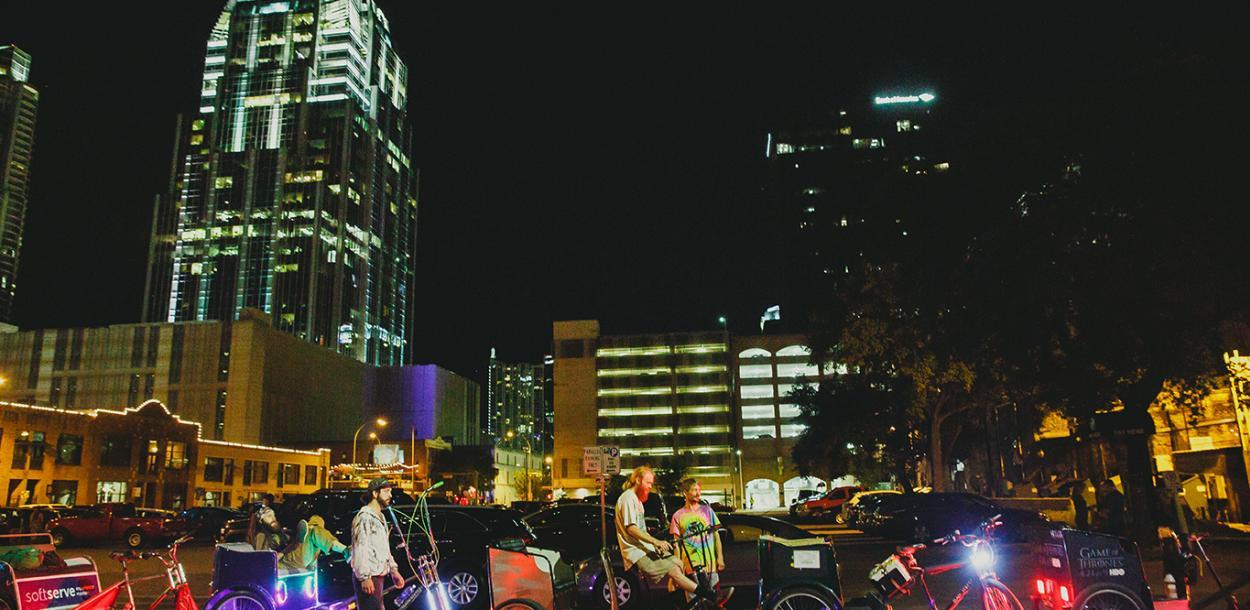Pedi Cabs wait in downtown Austin at night