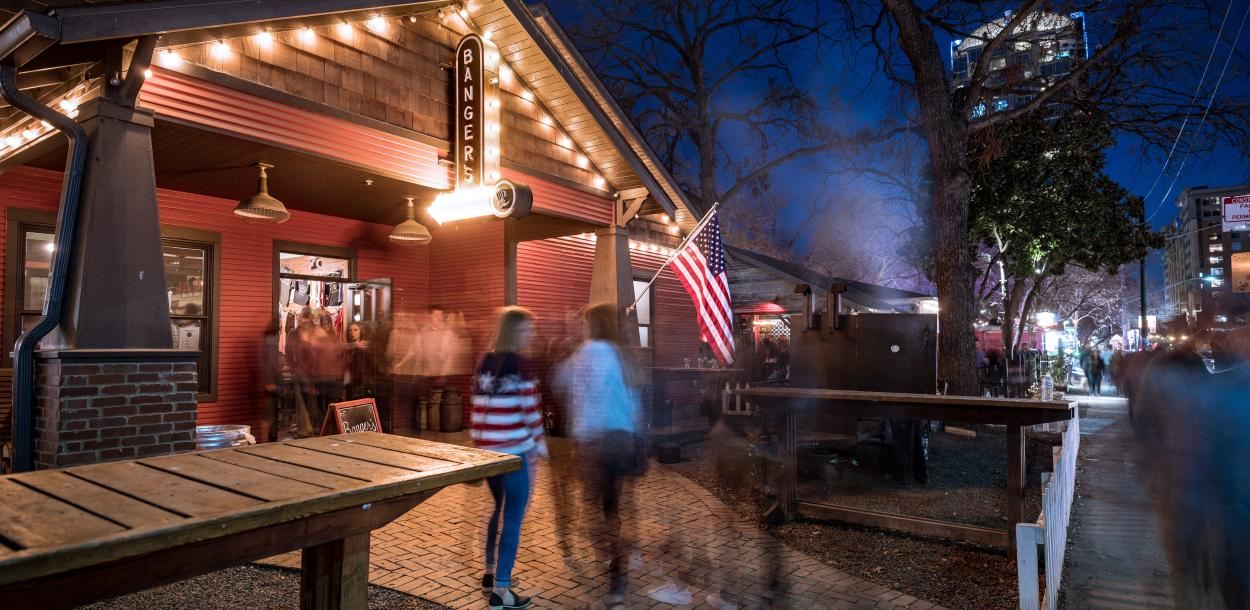 exterior of Bangers Sausage House and Beer Garden at night on rainey street in austin texas