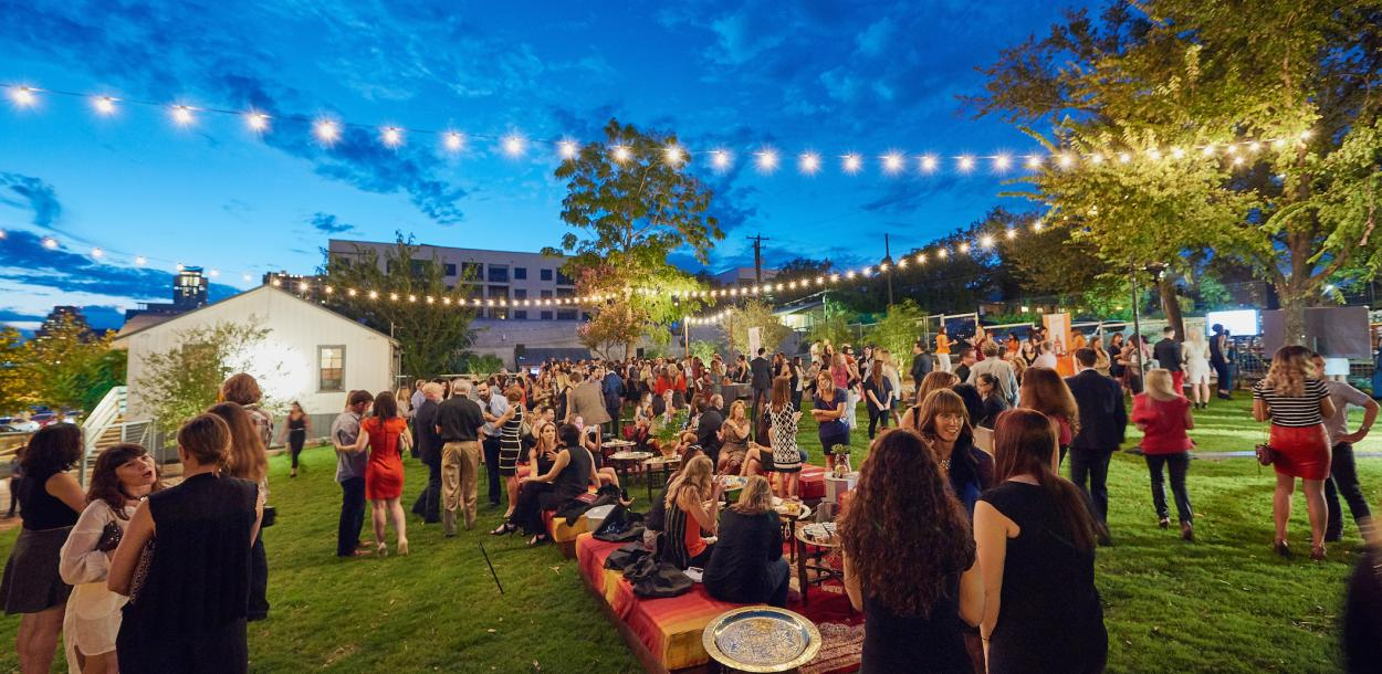 twilight at fair market outdoor event venue with people and twinkle lights in austin texas