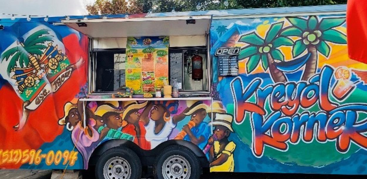 Photo of Kreyol Korner food truck with spray paint artwork in Austin Texas