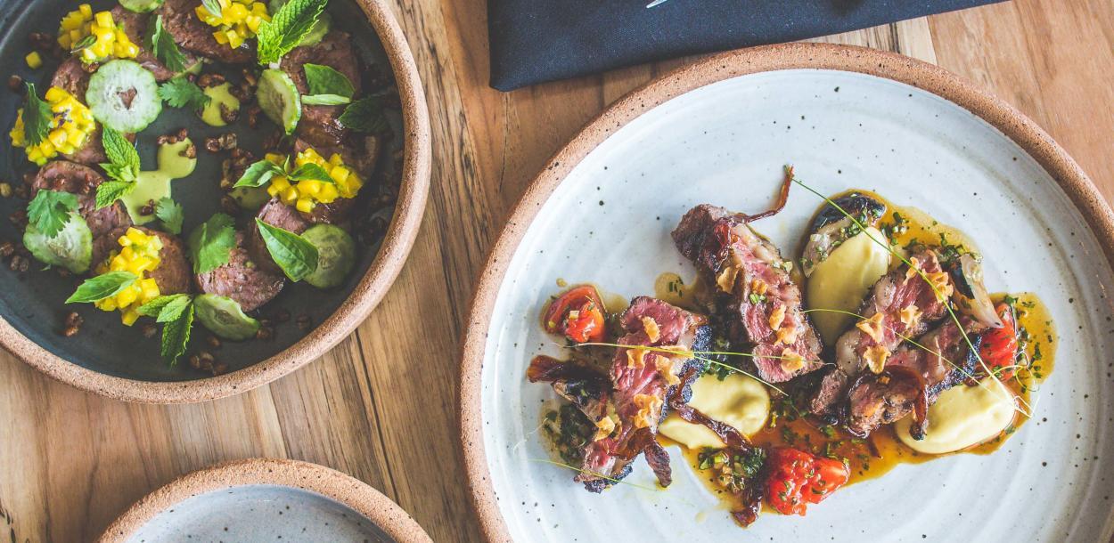 Plates of Lamb Sausage and Ribeye