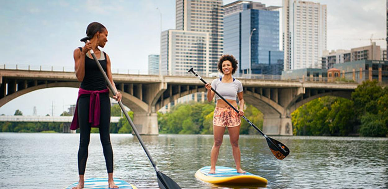 Women stand up paddleboarding on Lady Bird Lake in Austin Texas