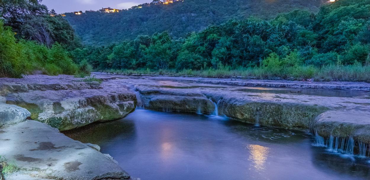 Austin Barton Creek Greenbelt at twilight with waterfalls in the creek