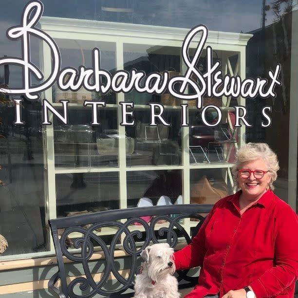 Susan Hoechner in front of Barbara Stewart Interiors