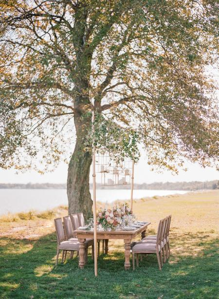 A table is set for a wedding reception by the shores of the Chesapeake Bay.