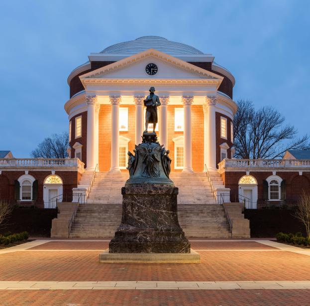 Evening photo of UVA Rotunda and Jefferson statue