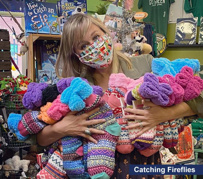 Catching Fireflies salesperson with mask and fuzzy socks