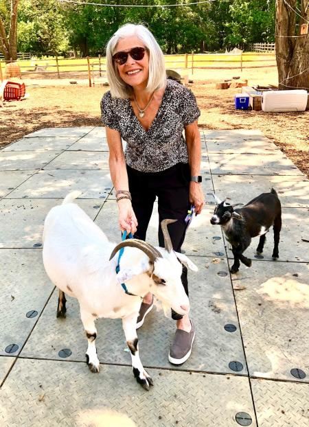 Lois Villemaire and a goat at Wild Kid Acres