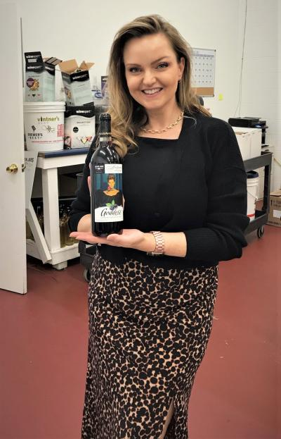 Ava Malissa Silver holding a bottle of the Ava Gardner Signature Wine.
