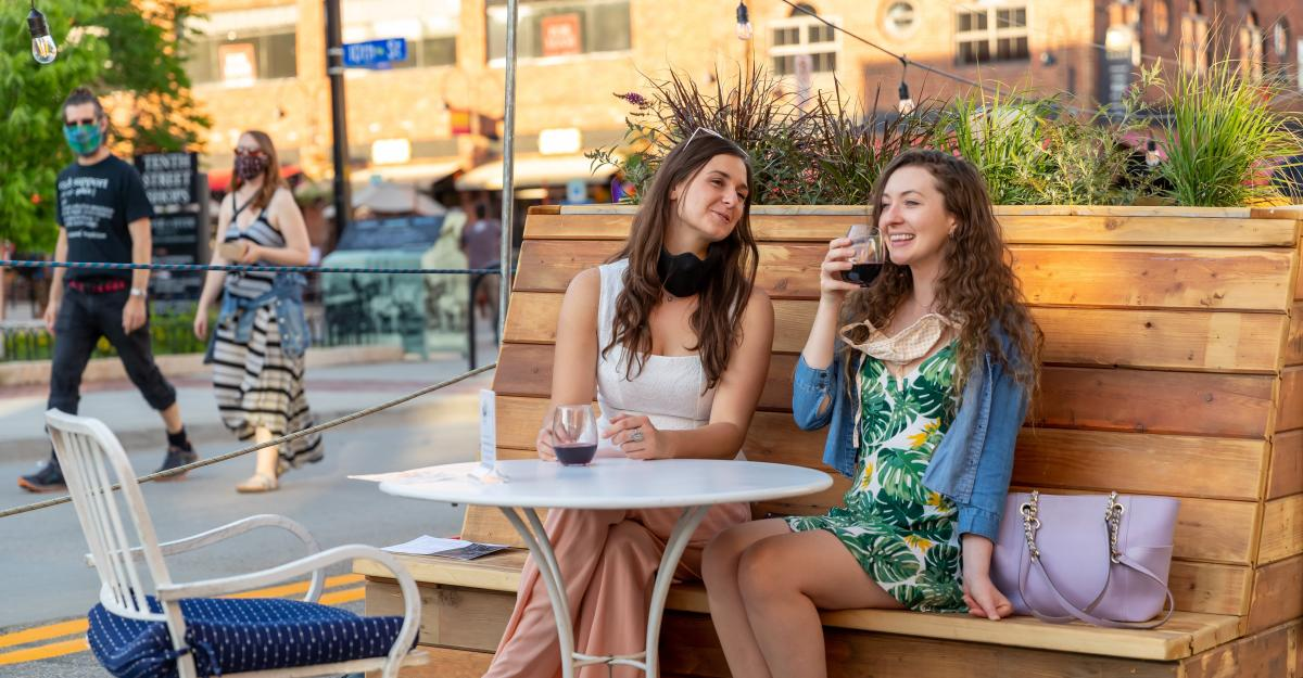 Two women dining al fresco on Pearl Street Mall in Downtown Boulder