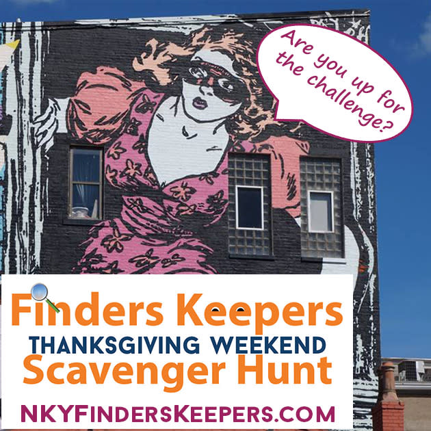 The Faile mural in Covington Kentucky of a cat burglar with the words, Are you up for the challenge? for the Thanksgiving scavenger hunt