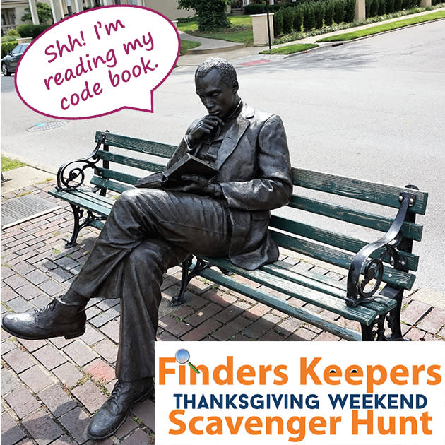 James Bradley statue in Covington Kentucky with the words Shh! I'm reading my code book. For the local Thanksgiving Scavenger Hunt